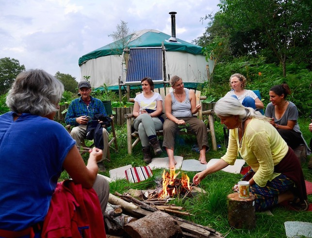 circle of people around a fire